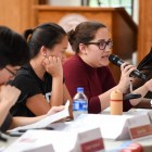 Students speak at an S.A. meeting on September 13 about the security fees.