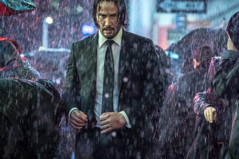 Keanu Reeves looks intimidating in the rain.