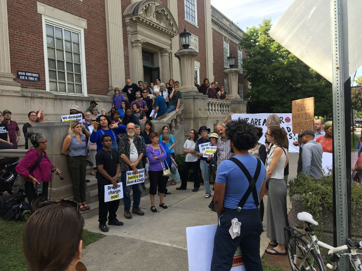 Over 100 protesters flooded the Tompkins County Courtroom to rally against the arrest of two young black Ithaca residents facing criminal charges for resisting arrest.