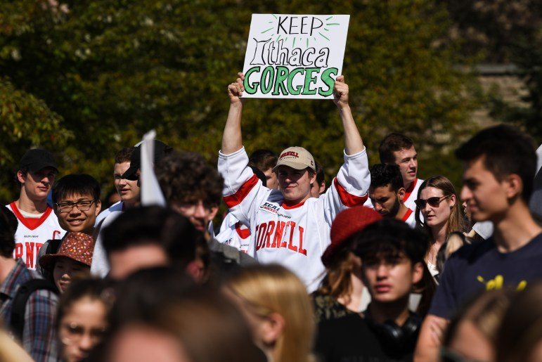 Zach Bramwell '22, a forward on the men's hockey team, hold up a sign during the Global Climate Strike on September 20th, 2019. (Boris Tsang/Sun Photography Editor)