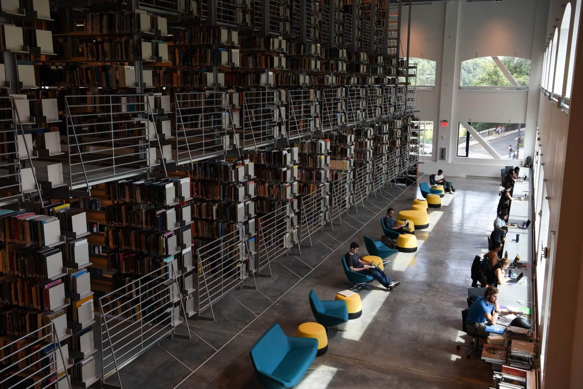 Cornell students studying in the new Mui Ho Fine Arts Library.