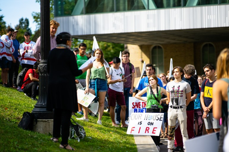 On Friday, hundreds of students and faculty joined demonstrators across the world in the Global Climate Strike. A group of protesters started near Rand Hall before marching to Ho Plaza. (Harry Dang/Sun Staff Photographer)