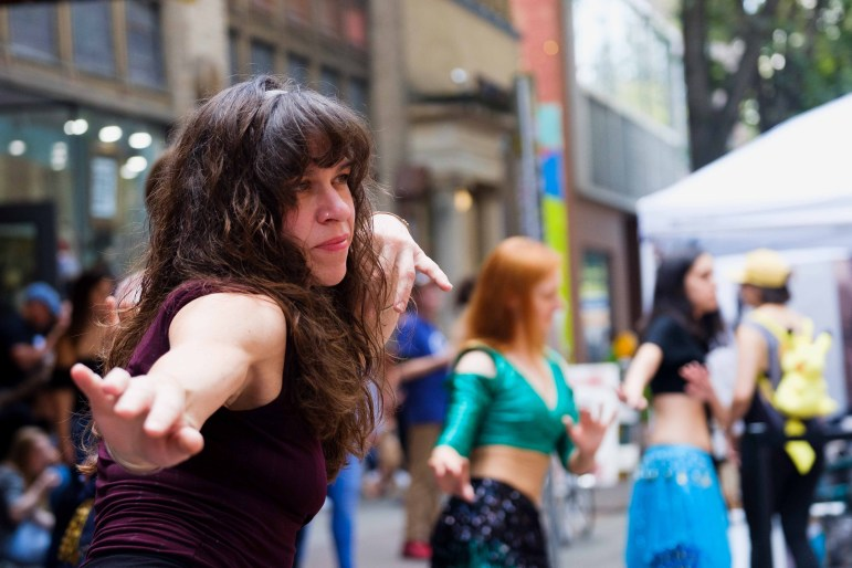 A variety of performers took to the streets during the festival. (Michael Suguitan/Sun Staff Photographer)