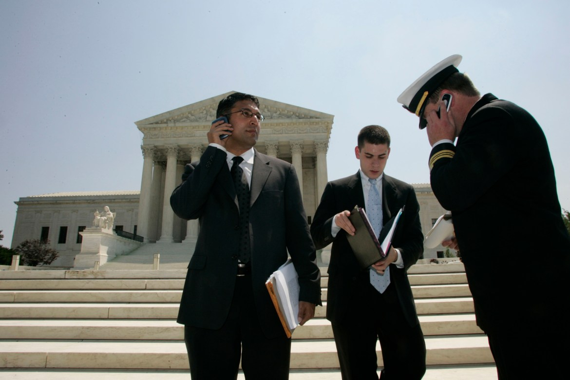 Neal Katyal, far left, emerging from the Supreme Court building in Washington after a haering on military tribunals on June 29, 2006.