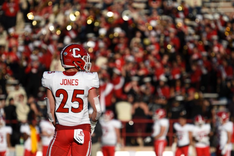 Cornerback David Jones stands in front of the Homecoming crowd as he prepares for the next play against Georgetown. The Red struggled to find momentum throughout the game, ultimately falling 14-8 in its home opener. (Boris Tsang/Sun Photography Editor)