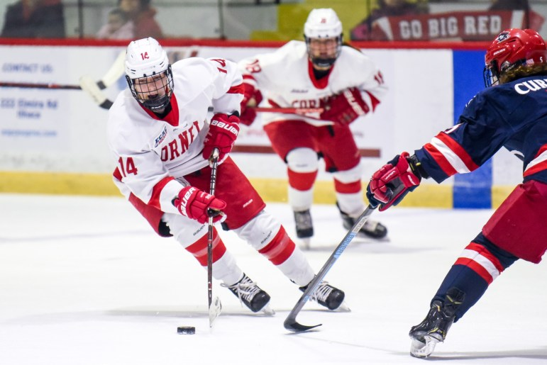Senior defenseman Jaime Bourbonnais advances the puck at the game against No. 8/9 Robert Morrison on Friday. The Red claimed a 6-0 victory that night and a 3-0 win the next day. (Boris Tsang/Sun Photography Editor)
