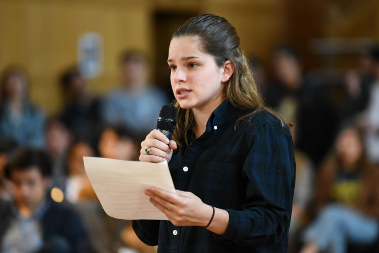 Marisabel Cabrera, '21 president of the Puerto Rican Students' Association, speaks in favor of the public statement at the Student Assembly meeting at Willard Straight Hall.