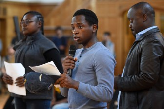Pacifique Nshimiyimana, an Alliance for Science fellow, speaks against the public statement at the Student Assembly meeting at Willard Straight Hall.