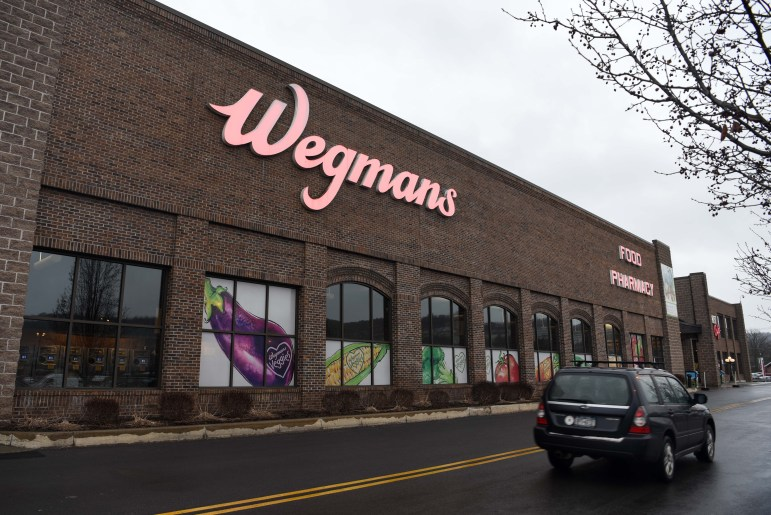 Wegmans has been sued by two customers for violating quality rules for their vanilla ice cream products.