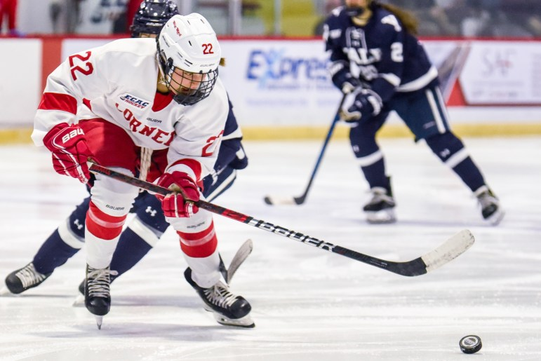 Junior forward Maddie Mills advances the puck against Yale on Friday. Mills scored one goal in the 6-0 shutout victory. (Boris Tsang/Sun Photography Editor)