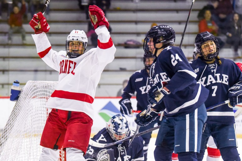 Sophomore forward Gillis Frechette celebrates after scoring to put the Red up 5-0 against Yale in the second period. (Boris Tsang/Sun Photography Editor)