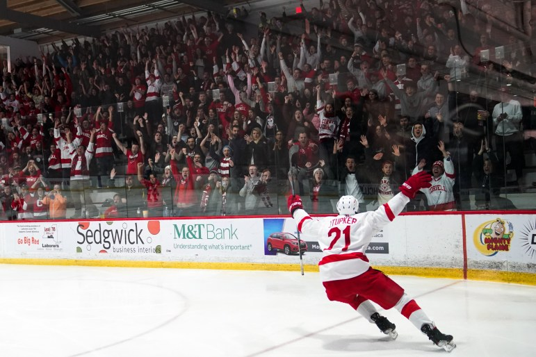 Freshman forward Zach Tupker celebrates after scoring his first goal of his Cornell career to put the Red up 6-1 against Yale. Cornell finished the game 6-2 to extend its season-opening winning streak to four. (Ben Parker/Sun Assistant Photography Editor)