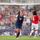Carli Lloyd celebrates her goal in a match against Japan.
