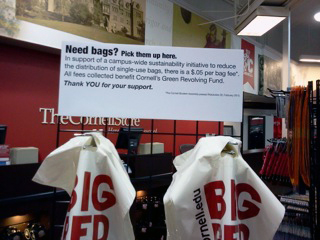 The move to tax paper bags five cents has come as a variety of retailers, such as the Cornell Store (above), have moved to push patrons to use reusable bagging instead.