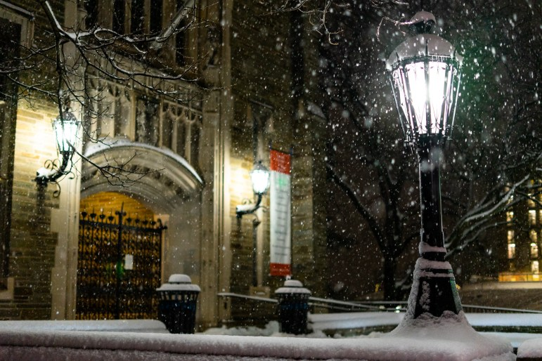 Snow falls in front of Willard Straight Hall amid a Winter Storm Watch during the early hours of Monday morning. (Harry Dang/Sun Staff Photographer)