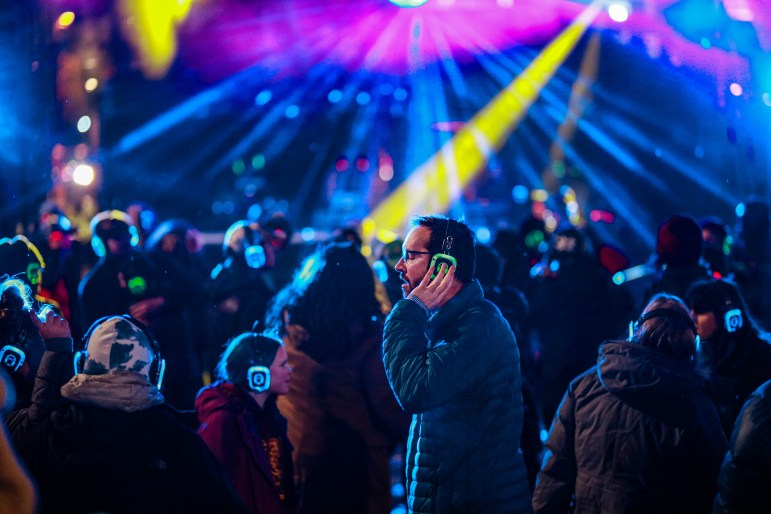 Lights stream across the Bernie Milton Pavilion as festival goers listen and dance to music from headphones during the silent disco on Friday. (Michael Wenye Li/Sun Senior Photographer)