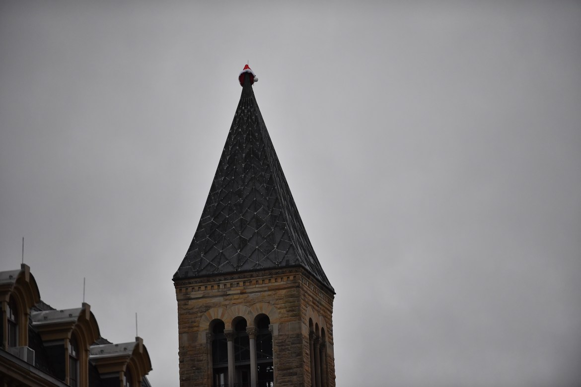 A santa hat caps the famous McGraw Tower on Sunday.