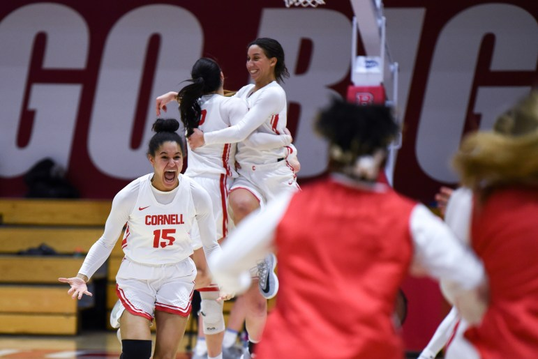 Sophomore forward Theresa Grace Mbanefo celebrates after the buzzer at the women's basketball game against Columbia on Saturday. The Red won in overtime, 80-77. (Boris Tsang/Sun Photography Editor)