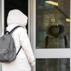 A student wearing a face mask enters Cornell Health on January 24th, 2020. (Boris Tsang/Sun Photography Editor)