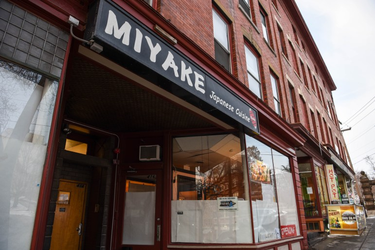 Papers cover the windows of Miyake on Tuesday. The restaurant is closing after 17 years and will be replaced by Masita, a new Pan-Asian restaurant, this February. (Boris Tsang/Sun Photography Editor)