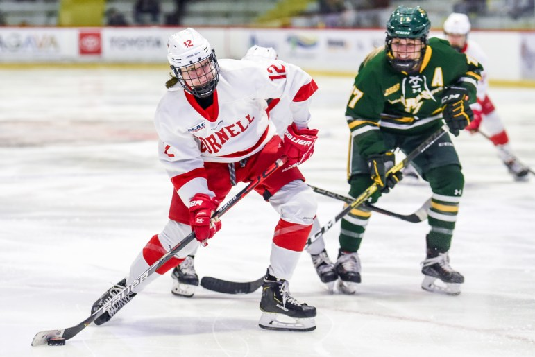 Freshman forward Izzy Daniel moves the puck at the women's hockey game against Clarkson on Friday. After five minutes of overtime, the game ended in a 1-1 tie. (Boris Tsang/Sun Photography Editor)
