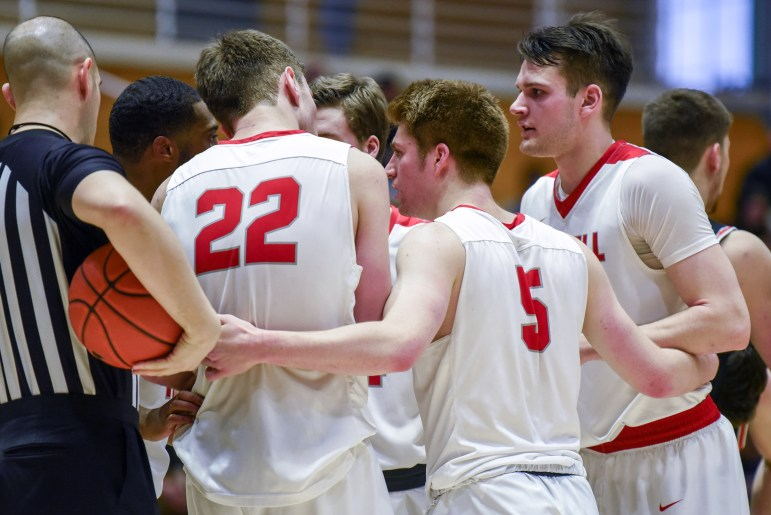 The Cornell men's basketball team confers after a foul call during the men's basketball game against Princeton on Saturday. The Red finished off strong for a victory against their Ivy League opponent. (Boris Tsang/Sun Photography Editor)