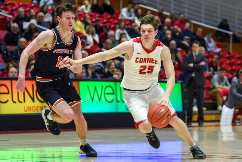 Sophomore guard Dean Noll dribbles the ball at the men's basketball game against Princeton on Saturday. The Red won 73-62 against Princeton at Newman Arena. (Boris Tsang/Sun Photography Editor)