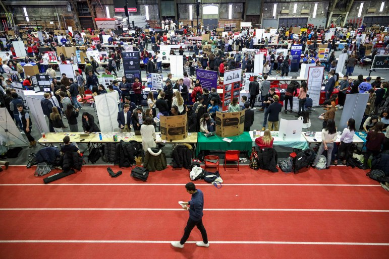 At Barton Hall, Students visit club booths at ClubFest this Sunday. Hosting over 1000 clubs and organizations, ClubFest provides students with the opportunity to check out on-campus groups. (Michael Wenye Li/Sun Senior Photographer)