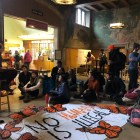Student protesters from Climate Justice Cornell, Friends of Farmworkers, Cornell Dream Team and Cornell Welcomes Refugees marched from Bailey Hall to Willard Straight Hall where they held a teach-in on global issues ranging from climate change to labor practices in Qatar.