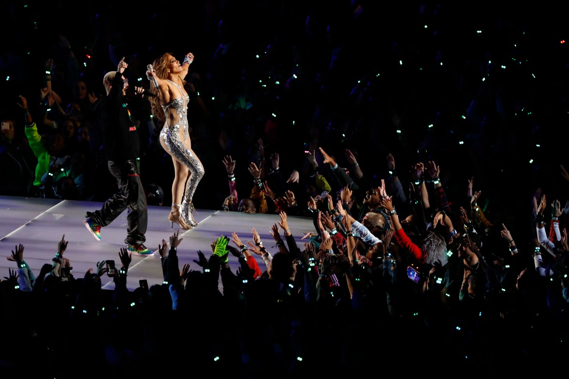 Jennifer Lopez performs with J Balvin during the halftime show of Super Bowl LIV at Hard Rock Stadium in Miami Gardens, Fla., Feb. 2, 2020. (Scott McIntyre/The New York Times)
