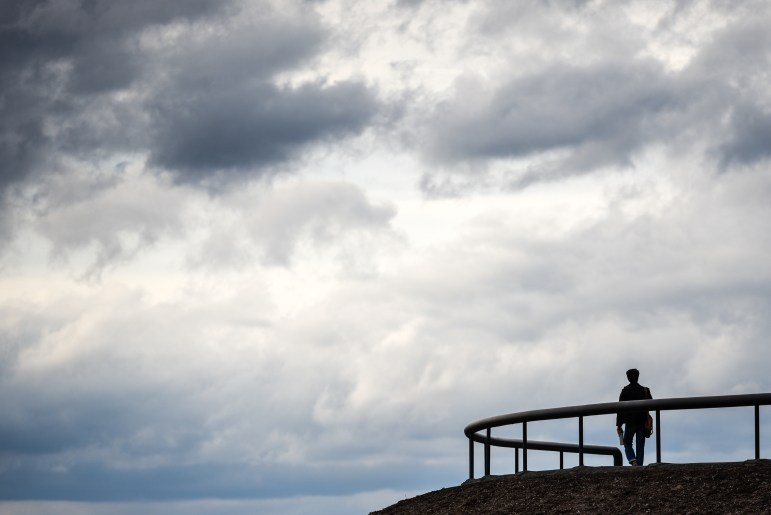 A lone student walks along the top of Libe Slope on Friday. (Boris Tsang/Sun Photography Editor)