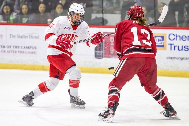 Sophomore forward Gillis Frechette slices the Lynah Rink air with her hockey stick at the women's ECAC semifinals against Harvard on Saturday. (Boris Tsang/Sun Photography Editor)