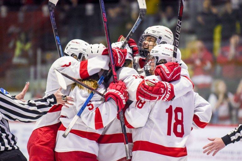 The women's hockey team celebrates after a goal from sophomore forward Gillis Frechette, putting the Red up 2-0 at the ECAC championship game against Princeton on Sunday. The game ended in a 3-2 Big Red overtime loss. (Boris Tsang/Sun Photography Editor)