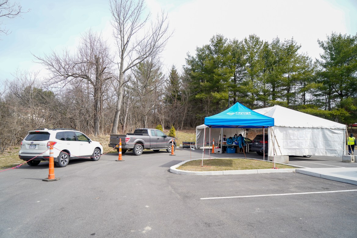 Ithaca's drive through testing site rests in a driveway outside a building that was formerly Women's Health of CMA.