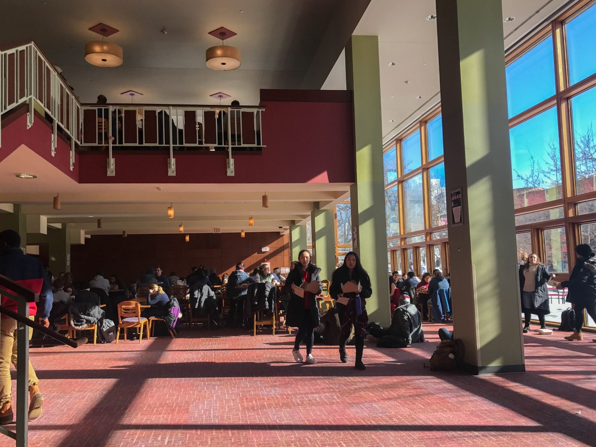 Students walk through Trillium Dining Hall in January 2019. Trillium has closed alongside many other campus eateries during the coronavirus outbreak — leaving some dining staff, including student workers who remain on campus, unemployed.