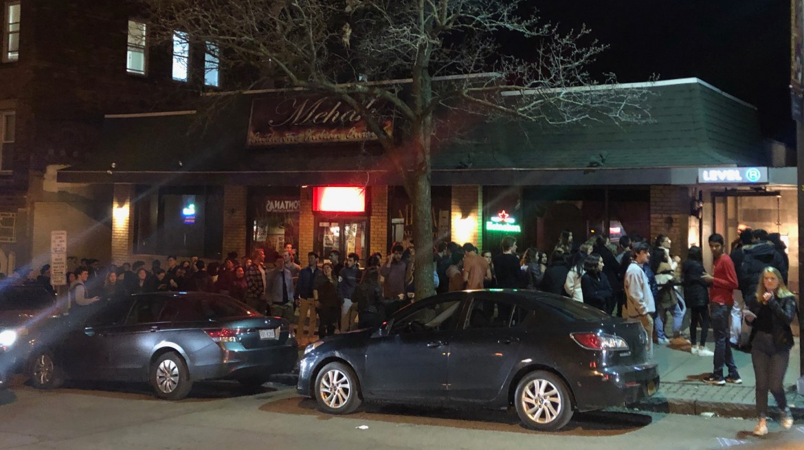 A line of students stretched down Eddy Street outside Level B in Collegetown late Wednesday night. Parties continued into the weekend as classes were suspended.