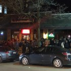 A line of students stretched down Eddy Street outside Level B in Collegetown in mid March. Parties continued into the weekend as classes were suspended.