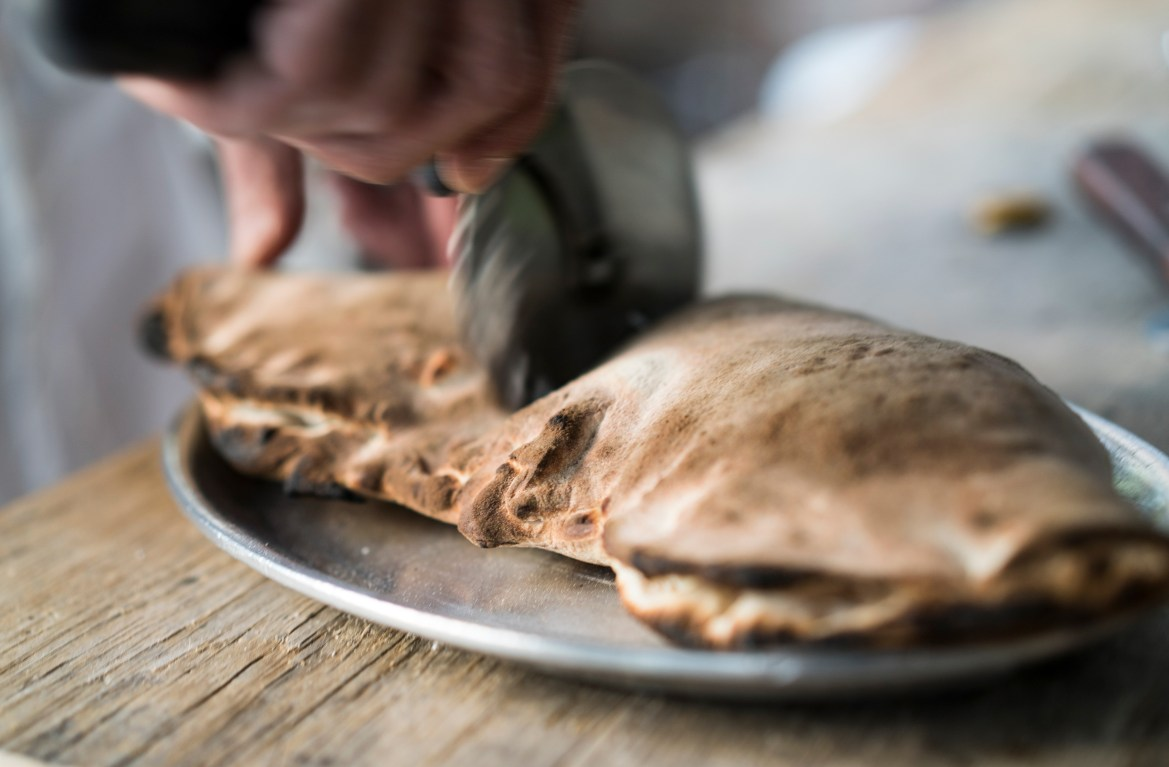 Pg-10-Dining-Calzone-(Todd-Heisler-via-NYTimes)