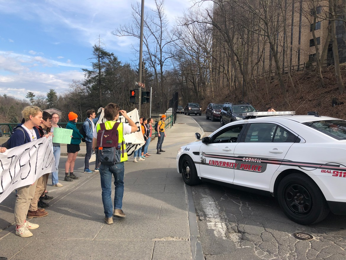 Climate Justice Cornell protesters block Thurston Avenue Bridge on Monday afternoon to call for fossil fuel divestment.
