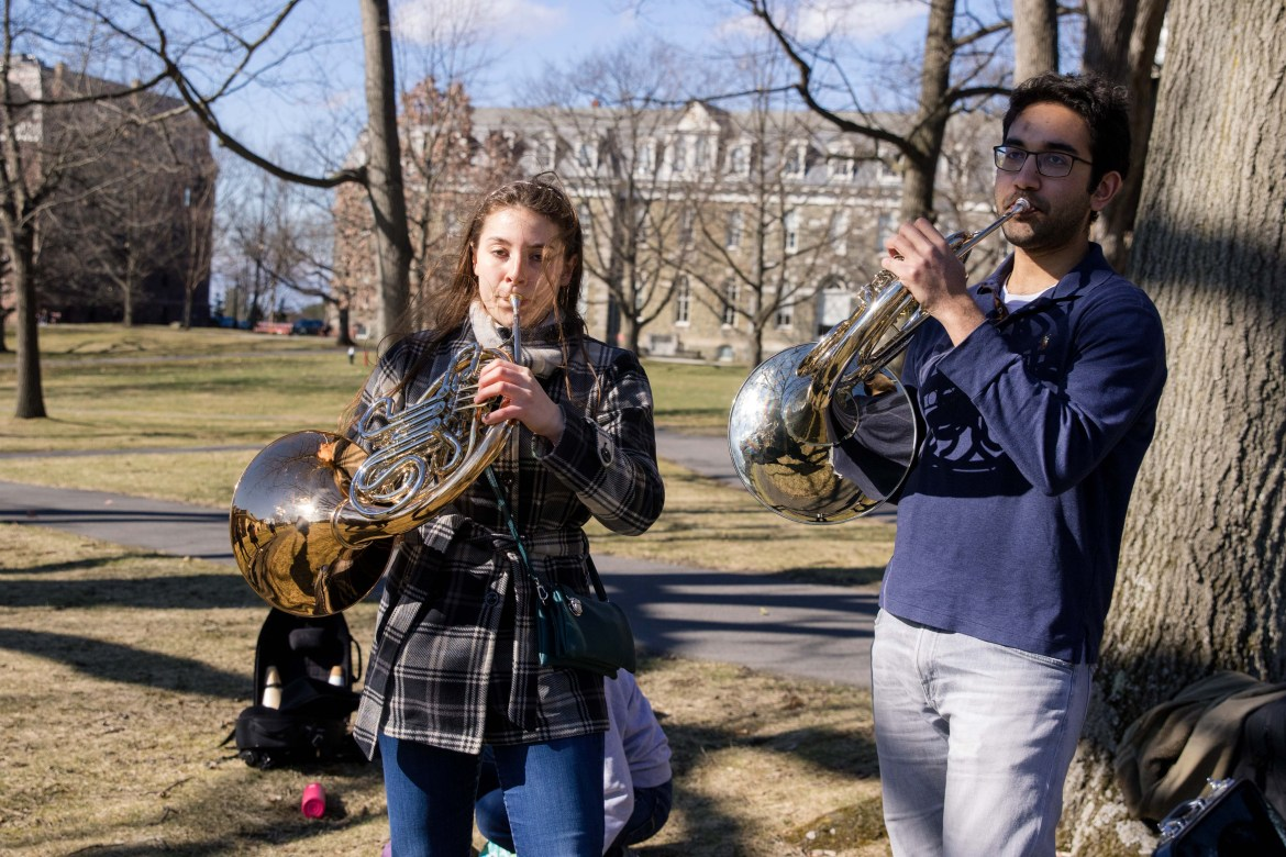 Two students perform on the Arts Quad the day in-person classes were canceled. Writing 'Together' was another moment of connection through music, for Arthur Schlosser '67.