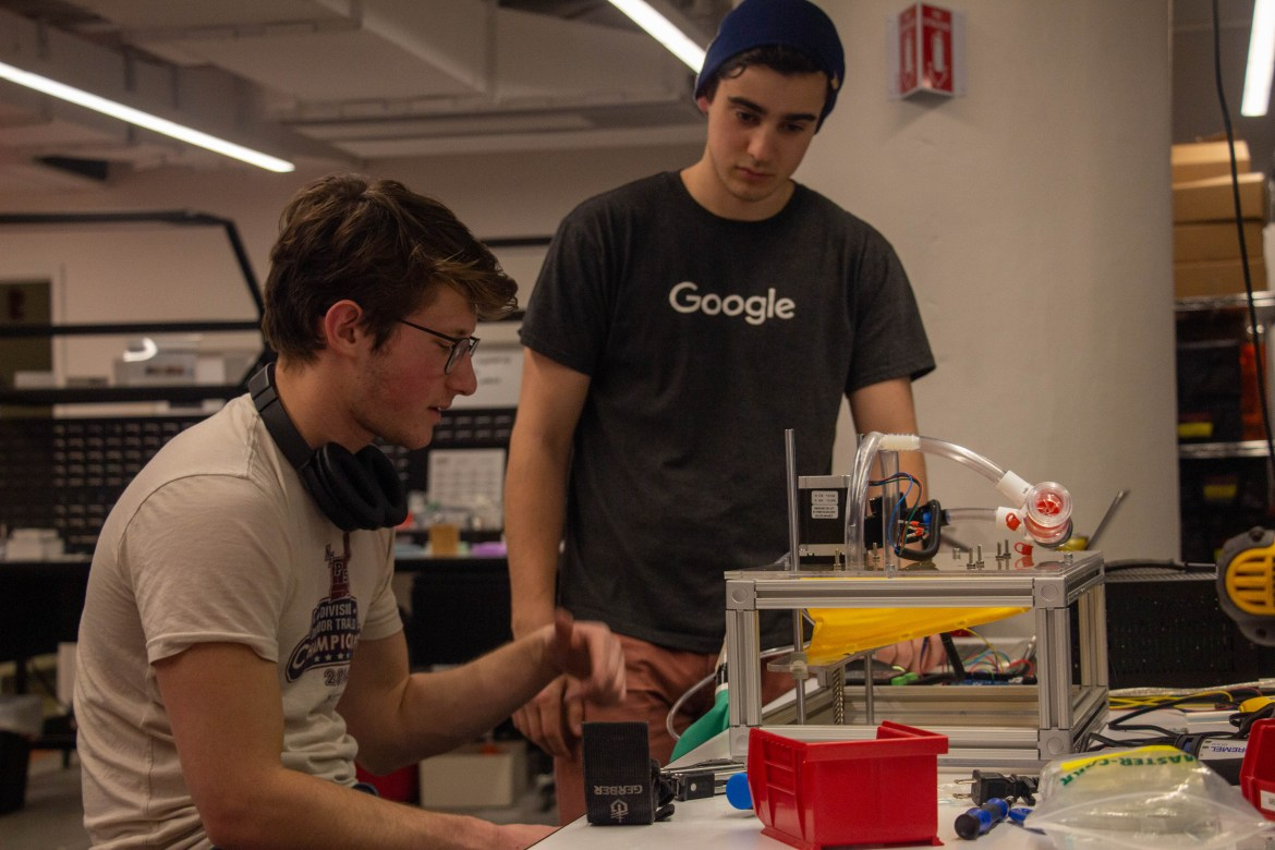 Sam Feibel '20 (left) designing a prototype with another team member.