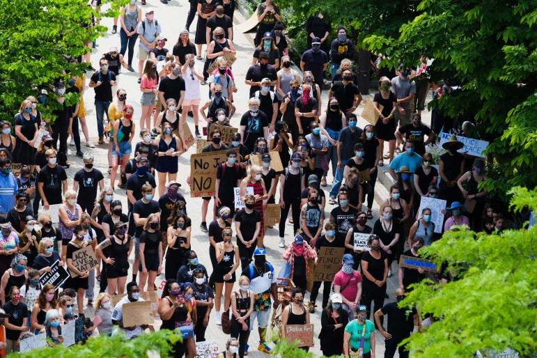 Hundreds of Ithacans attend a protest for the Black Lives Matter movement on The Commons on Friday, June 5. (Michael Suguitan / Sun Staff Photographer).