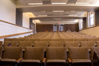 An empty lecture hall in Goldwin Smith Hall. Droves of students left campus once President Martha E. Pollack in-person classes during the spring semester.