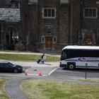 A student makes his way to a Coach USA Shortline bus on West Campus on March 16, 2020.