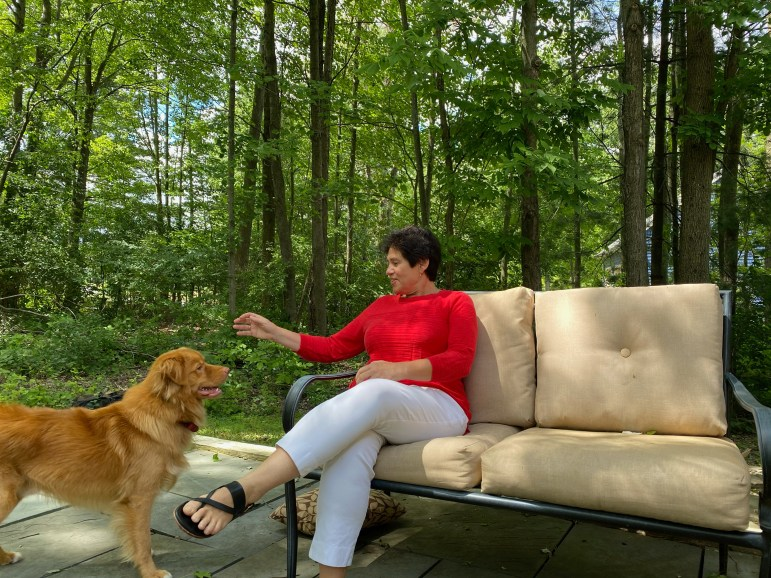 Mitrano with her golden retriever, Teddy, in her backyard.