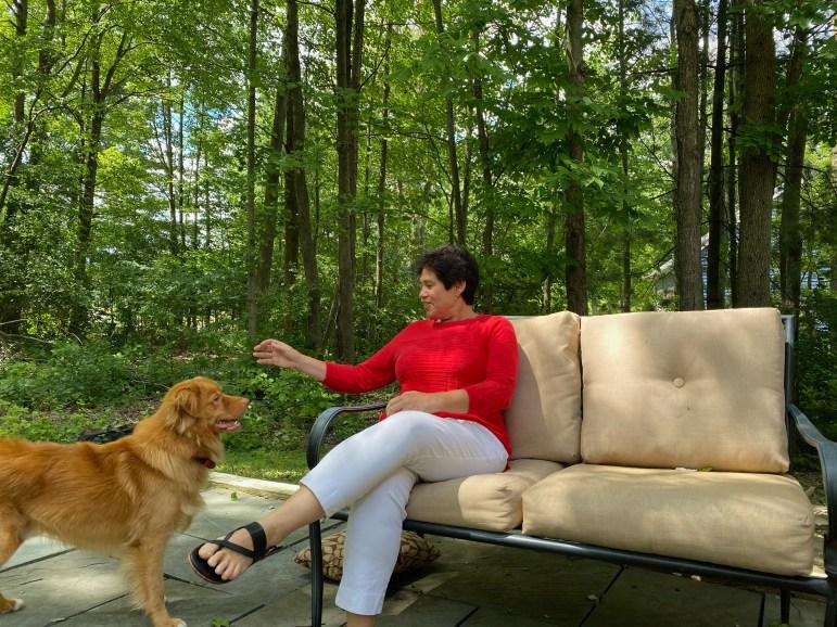 Mitrano with her golden retriever, Teddy, in her backyard.