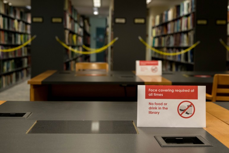 Mann Library is much emptier this fall, and signs enforcing social distancing procedures are dispersed throughout the study spaces.