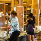 From behind the plexiglass, student workers are an essential part of Cornell's surveillance testing plan and are regularly administering COVID-19 tests to Cornell students and faculty.