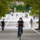 Making the most of the nice weather, Cornell students get used to exercise — like biking with a mask — in a world with COVID-19.