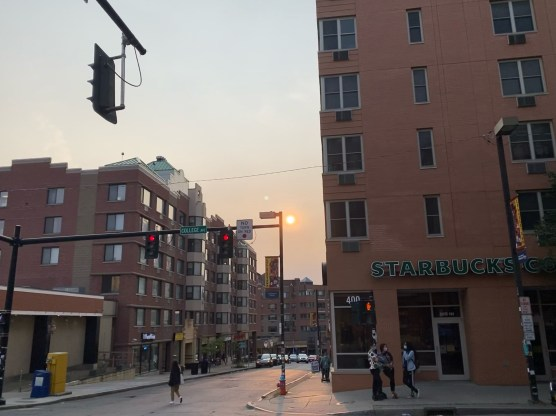 The sunset in Collegetown on Tuesday evening was partially obscured by haze.